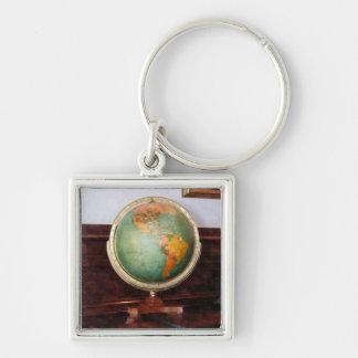 Globe on Piano Silver-Colored Square Keychain