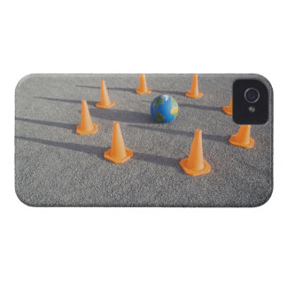 Globe on sand outdoors surrounded by traffic iPhone 4 cover
