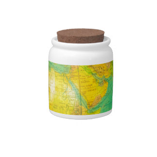 Globe with planet earth isolated on white candy jar