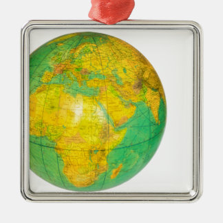 Globe with planet earth isolated on white metal ornament