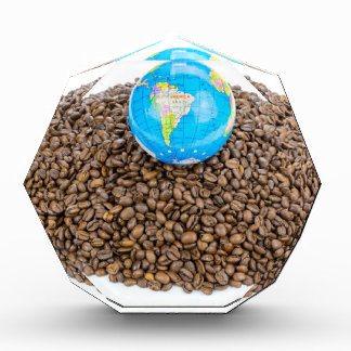 Globe with world on heap of whole coffee beans award