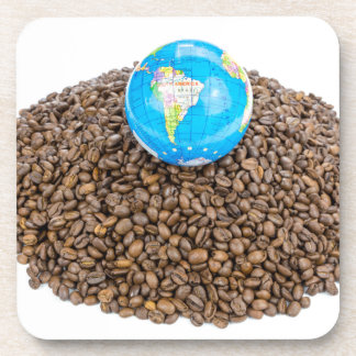 Globe with world on heap of whole coffee beans beverage coaster