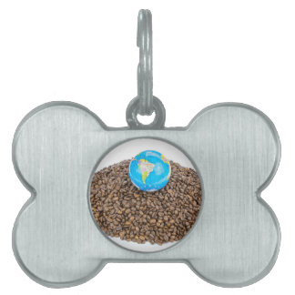 Globe with world on heap of whole coffee beans pet tag