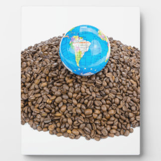 Globe with world on heap of whole coffee beans plaque