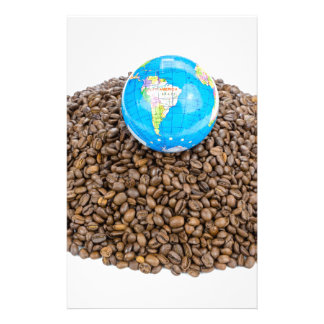 Globe with world on heap of whole coffee beans stationery