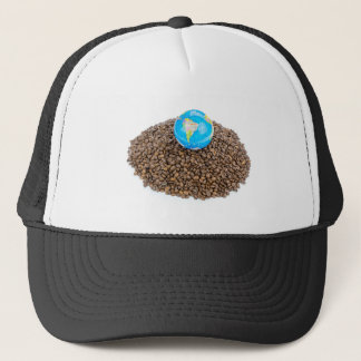 Globe with world on heap of whole coffee beans trucker hat
