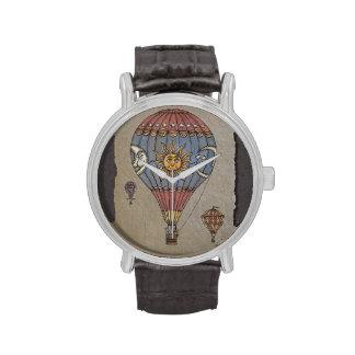 Globo colorido del aire caliente relojes