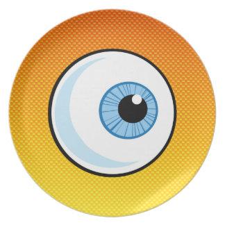 Globo del ojo amarillo-naranja plato de comida