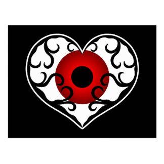 Globo del ojo rojo en corazón tarjetas postales