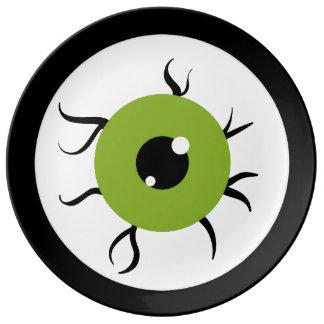 Globo del ojo verde y negro retro plato de cerámica