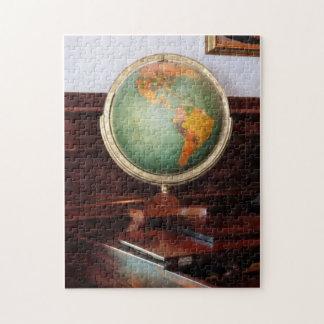 Globo en piano puzzle con fotos