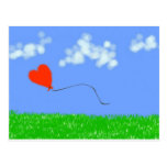 Globo feliz del corazón postal