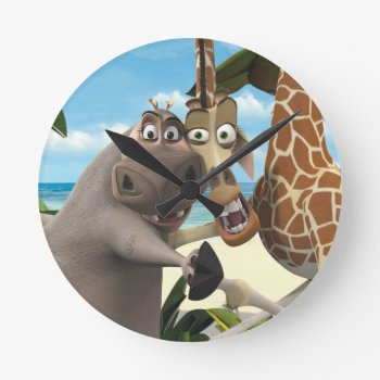 Gloria And Melman Hand Holding Round Clock by madagascar at Zazzle
