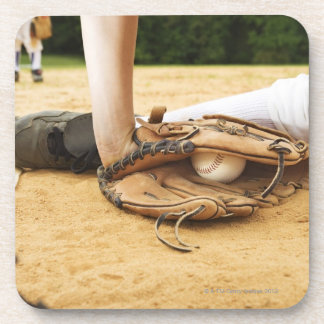Glove of baseball player tagging runner out, drink coaster