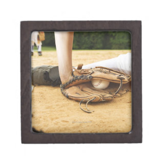 Glove of baseball player tagging runner out, gift box