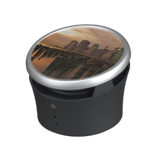 Glow of sunset during stormy skies over East Bluetooth Speaker