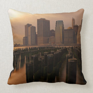 Glow of sunset during stormy skies over East Throw Pillows