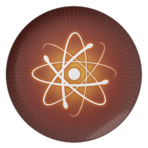 Glowing Atom on orange background Dinner Plates