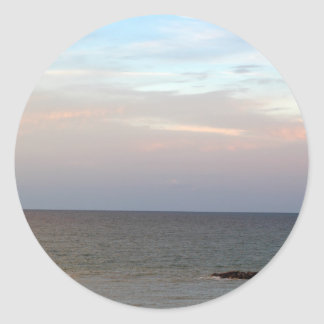Glowing clouds over the Adriatic Sea in Italy. Classic Round Sticker