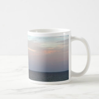 Glowing clouds over the Adriatic Sea in Italy. Coffee Mug