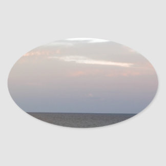 Glowing clouds over the Adriatic Sea in Italy. Oval Sticker