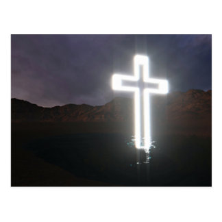 Glowing cross symbol on river bank postcard