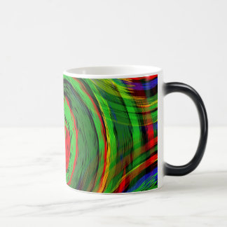 Glowing green and fluoresent red swirl design magic mug