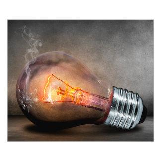 Glowing Light Bulb Cracked Glass Smoke Photo