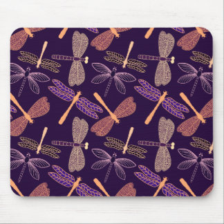 Glowing night dragonflies on dark plum background mouse pad