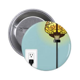 Glowing plugged in brain pinback button