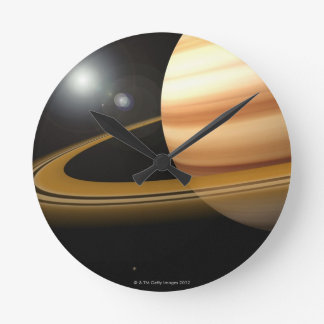 Glowing Stars and a Moon of Saturn Wallclocks