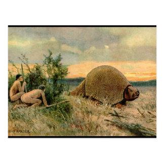 Glyptodon y hombres de cueva que cazan la imagen d tarjeta postal