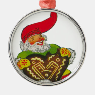 Gnome with a heart round metal christmas ornament