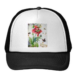 Gnomo en una flor de la amapola gorros