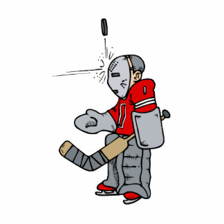 Goalie blocking puck with face statuette