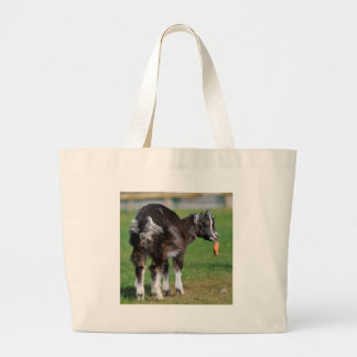 Goat eating carrot large tote bag