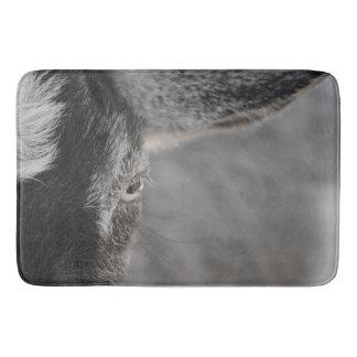 goat eye close up caprine farm animal image bath mat