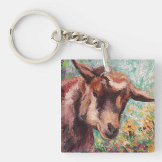 Goat key chain on flowered background