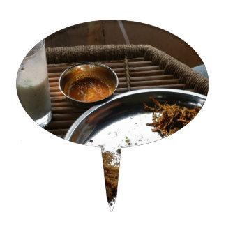 Goce de una placa de la comida de Rajasthani en un Decoraciones De Tartas