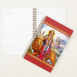 "Goddess Durga with Lion Painting Planner<br><div class=""desc"">Let blessed Mother Durga help you keep life and household organized with this artistic Hindu goddess planner calendar. The lion represents power, will and determination. Mother Durga riding the lion symbolises her mastery over all these qualities. This suggests to the devotee that one has to possess all these qualities to...</div>"