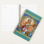 "Goddess of Knowledge Saraswati Hindu Divinity Planner<br><div class=""desc"">Let Goddess of Knowledge Saraswati help you keep life and household organized with this artistic Hindu goddess planner calendar. Saraswati is the Hindu goddess of knowledge, music, arts, wisdom and learning. She is a part of the trinity of Saraswati, Lakshmi and Parvati. All the three forms help the trinity of...</div>"