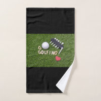 Going Golfing with golf ball and tee on green Hand Towel