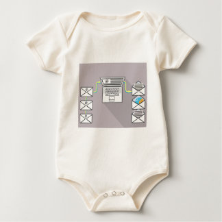 Going through emails on laptop baby bodysuit