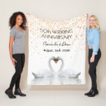 """Gold 50th anniversary white swans in love fleece blanket<br><div class=""""desc"""">Two beautiful swans in love bending their heads toghether and forming a heart. White elegant background, perfector for a wedding anniversary! A swan couple stay together for life, so they are the perfect symbol of love. With the text: 50th Anniversary. Template for two names, black letters. With golden confetti rain...</div>"""