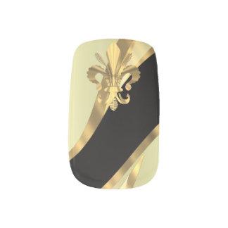 Gold and black fleur de lys minx nail art