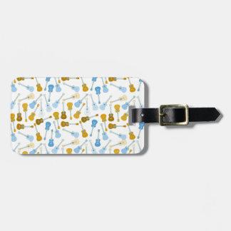 gold and blue ukuleles luggage tag