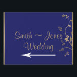 "Gold and Navy Blue Filigree Wedding Direction Sign<br><div class=""desc"">This beautiful design, called Gold and Navy Blue Filigree Floral Wedding, has an elegant nature inspired design. The background is navy blue with a thin gold border. On the front there is a beautiful floral filigree pattern with an inset of navy blue for your names. Your text goes on the...</div>"