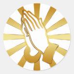 GOLD AND WHITE PRAYING HANDS CLASSIC ROUND STICKER
