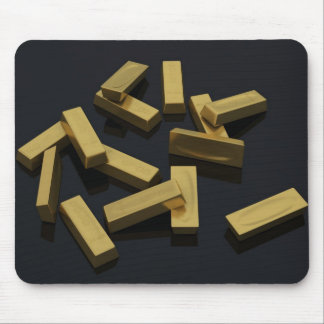 Gold bars in bulk on a black background mouse pad