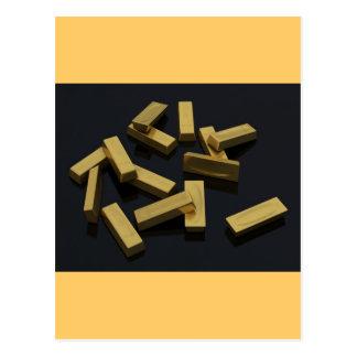 Gold bars in bulk on a black background postcard